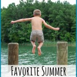little boy jumping off dock into water