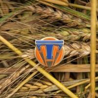 tomorrowland-pin-wheat
