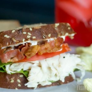 Buffalo chicken sandwich, piled high with bacon, buffalo chicken deli meat, lettuce and tomato!